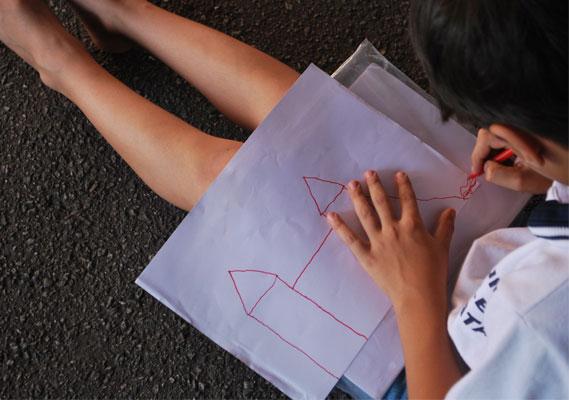 cidade para crianças: Kelvin desenha seu projeto de cidade